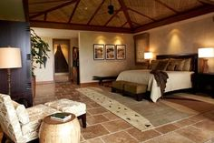 Beautiful Bedroom ~ This Hawaiian home takes nature to the interior by highlighting custom items like concrete bathtubs and sinks. The large, pocket doors create the walls to this home--walls that can be added and removed as desired
