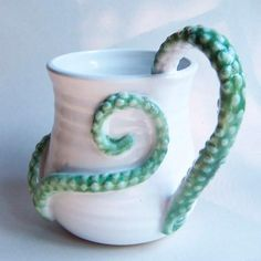 ceramic cup with octopus tentacles -I bet Mark could make this for me....