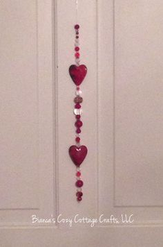 A personal favorite from my Etsy shop https://www.etsy.com/listing/261596243/valentine-gift-beaded-suncatcher-red