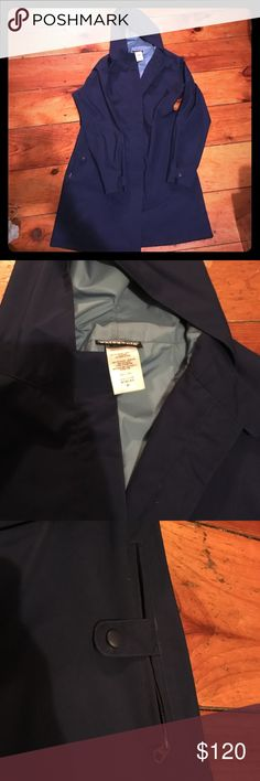 Patagonia rain coat Great very flattering Patagonia raincoat. Dark blue exterior. Great and waterproof just too small for me. Has belt attached snap cuffs snap and zip pockets. Hits above the knee. Happy to take more pics of details if needed. Patagonia Jackets & Coats