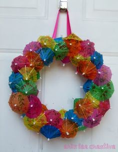 Drink umbrella wreath. Great decoration for a theme party.