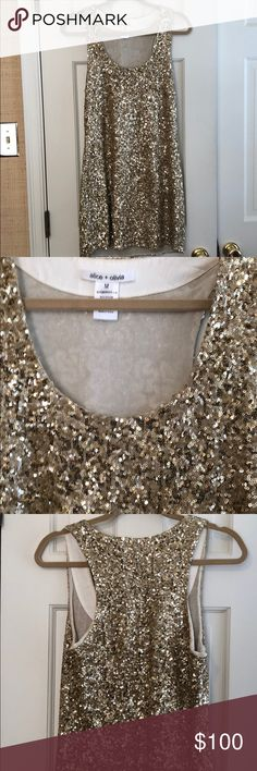 Alice and Olivia Gold Sequin Dress Love love love this Alice and Olivia dress! Selling it for my pregnant sister-in-law, wish it was my size! Gold sequin dress in great condition from smoke free home! Alice + Olivia Dresses Mini