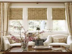 Breezy sitting room with white seating and Woven wood blinds. Cal us when you are ready for this look!
