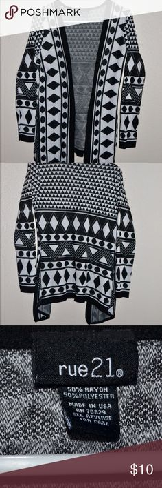 Stylish Black and White Cardigan Perfect piece of clothing to make your outfit really pop. Matches with just about everything. The tag says Medium just on the other side. True to size. Rue 21 Sweaters Cardigans