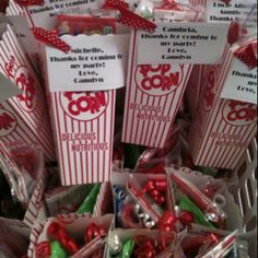 Goodie bags filled with candy and microwave popcorn for my daughter's bday party at the movie theater.