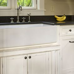 kitchen. farmhouse apron sink, faucet, soapstone counters, shaker cabinets (but not distressed)