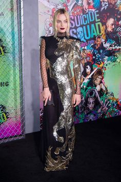 Here's a must-read article from ELLE:  Margot Robbie Wears Majestic Unicorn Dress to 'Suicide Squad' Premiere