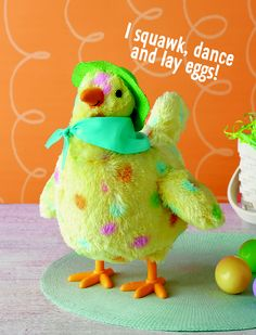 """She's back and ready to boogie down! She bobs up and down to a parody of """"Whoomp! (There It Is)."""" As she bobs, Mama Hen squawks and lays eggs - and this year Mama's got a brand-new Easter hat and scarf. Also check out The Eggs-Cellent Mama Hen accompanying book."""