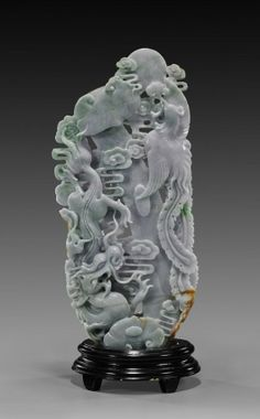 Chinese Carved Jadeite Dragon & Phoenix Group Tall Chinese openwork carved jadeite group; of vertical composition and depicting a dragon and phoenix with ruyi scepter; in lavender with light apple green and russet color suffusion.
