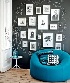 Chalkboard wall with doodles around a picture display - what a super cool idea!