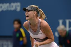Maria Sharapova (RUS)[3] in action against Marion Bartoli (FRA)[11] in a women's singles quarterfinal match at the US Open - Rob Loud/USTA