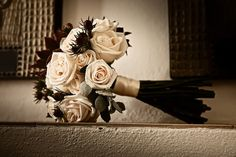 Wedding bouquet with ivory roses and maroon accents - photo by South Africa based wedding photographer Greg Lumley