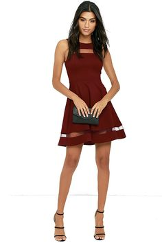 For the fashionista who's always striving for the next best thing, we recommend the Sheer Determination Burgundy Mesh Skater Dress! Medium-weight knit is formed to a sleeveless, seamed bodice with rounded neckline, and a sheer mesh decolletage. Fitted waist leads into a skater skirt with more mesh. Hidden back zipper.