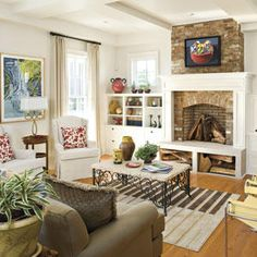 Raised Fireplace - 25 Cozy Ideas for Fireplace Mantels - Southernliving. This raised fireplace allows for wood storage beneath. The brick hearth meets the coffered ceiling and creates a striking structural feature.