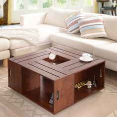 Add artisan-inspired style to your living room decor with this wine crate coffee table. This unique finish table features four-sided open shelf storage with keyhole accents and a center flip box tray insert. Store your books and magazines neatly, or display your favorite trinkets on this coffee table with It's rich finish that really makes your treasures stand out. Easily movable for cleaning under or repositioning, this table is mounted on moving wheels that run smoothly over your floor…