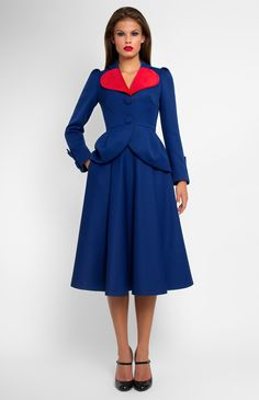 Genuine wool long-sleeve suit. Jacket with ruffled peplum and red velvet trim. Puckered half circle skirt. Side seam pockets. Hidden back zip closure.