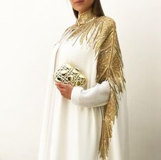 Fit for a queen. Stunning off white cape in crepe with intricate hand embroidered detailing. With weeks of work put into this amazing creation, it deserves a queen to carry it off . Street Hijab Fashion, Abaya Fashion, Modest Fashion, Couture Fashion, Boho Fashion, Fashion Dresses, Vintage Fashion, Mode Abaya, Iranian Women Fashion