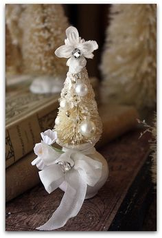 Lovely white tree on teensy little pot!!! Bebe'!!! Perfect way to use bottle brush vintage trees in  formal decor like  tables cape or on an accent table!!!