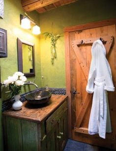 Remodeled bathroom: An antique hutch serves as a vanity, lending character to this tiny Santa Fe, New Mexico, bathroom.