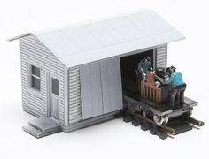 This paper model kit printable building includes a sliding vehicle door and workbench details. Fully adjustable for any track height, this paper model adds new dimensions to every model railroad wo…