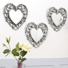 This set of 3 mirrors features an ornate scrolled vine style frame with a distressed metallic finish. A great addition to a hallway or ascending staircase or as a simple way to add light and decoration to your home this set of mirrors are versatile enough for any room. Each mirror comes with two simple hooks to easily affix to the wall. Perfect for Mother's Day! #Dibor