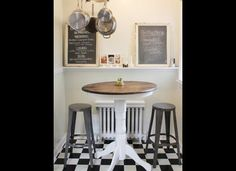 Another tasteful way for us to add an eat-in area in the galley kitchen. We could put this by the window wall where the cookbook stand is. Like the counter/bar shelf too.