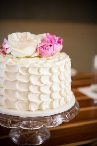 Simple cake with buttericing and fresh flowers.