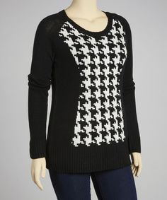 Comfy and cool, this sleek sweater is a stylish staple. Boasting a classic houndstooth print and a comfy cotton blend, this pretty piece is sure to become a fast favorite.