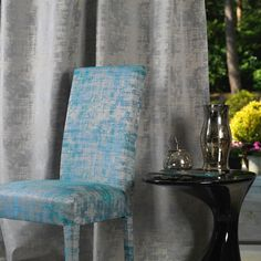 Metallic Silver Curtains and Blue Atoll Chair by Fibre Naturelle Miami Collection http://www.fibrenaturelle.com/fabric-collections/miami