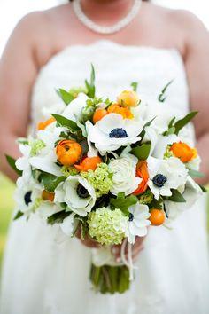 Salt Harbor Style, bridal bouquet of white and black anemones, (Panda Anemones), white ranunculus, kumquats, green viburnum, orange ranunculus