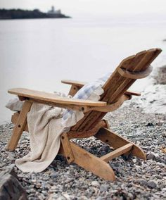Relax in a chair, with a book, wrapped in blankets by the lakeside. How do you relax? Hamptons Decor, The Hamptons, Adirondack Chairs, Outdoor Chairs, Outdoor Decor, Outdoor Furniture, Coastal Living, Coastal Decor, Country Living