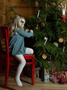 Katrina Tang Photography for Family&Home magazine Christmas 2011 kids fashion. Girl wearing a dress decorating a Christmas tree, winter, presents, holidays at home #katrinatang #tangkatrina