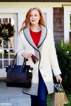 Winter must-have: An overcoat that works with everything from jeans and sweaters to sparkly cocktail dresses. This cozy colorblock style is a modern take on a classic winter-white coat.