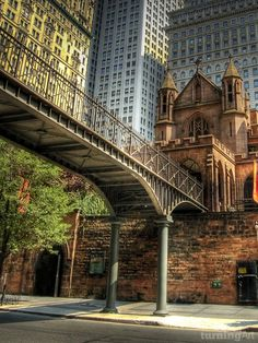 pinterest.com/fra411 #NYC - Trinity Church, Lower Manhattan (with its bridge connecting the church to its offices at 74 Trinity Place). The bridge was built to help people get across the street safely from the church - cars tend to speed up on this stretch of Trinity Place as they came out of the Brooklyn Battery Tunnel.