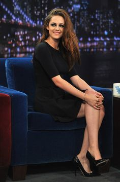 See! Kristen Stewart does smile... every once in awhile! lol