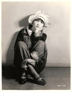Clara Bow donning bonnet, heels and overalls in The Runaway, 1926.  (Photo by Eugene Robert Richee)