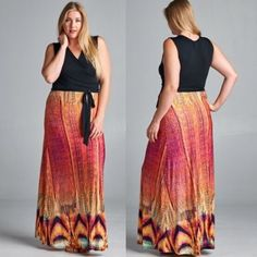 Phoenix Faux Wrap Maxi Dress Black faux wrap upper. Sash tie. Vibrantly colored skirt. Maxi length dress. Fit runs small. Made in U.S.A.. Brand new retail w/o tags. No trades, no holding, no offline/App transactions.      PRICE IS FIRM UNLESS BUNDLED                  5% off bundles  Dresses Maxi