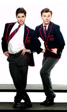 Darren Criss (05 February 1987).  Chris Colfer (27 May 1990).  Blaine Anderson and Kurt Hummel.  Glee.