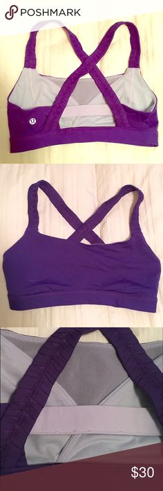 Inner Heart  Lululemon Sports Bra Grape purple Sports bra with pockets in front to stash your cash or rings. This was simply way too small for me and it was too much of a hassle to return. Never worn, it has just sat in my drawer. Please note the 3rd picture. I am a natural 36D and was popping out every where lol lululemon athletica Intimates & Sleepwear Bras