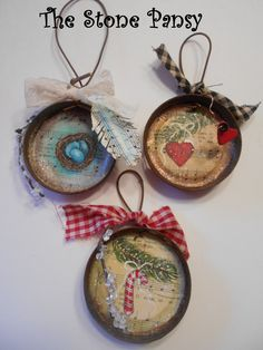 Upcycled canning ring ornaments. Hand painted and created by The Stone Pansy.