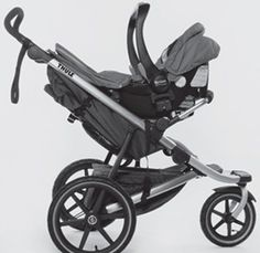 Thule Urban Glide Stroller and Jogger with car seat adapter holding car seat