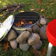NIfty camp fire idea! I once used the boot of my old magna as my kitchen bench with an old towel while i prepared the food, people looked at me like i was mad. But they didnt mind the roast chook id done in the campfire tho!