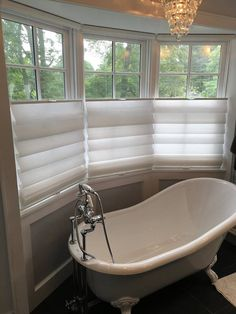 Lisa Scheff Designs - What a retreat!! We added beautiful top-down, bottom-up Hunter Douglas Vignette modern roman shades to provide privacy while still being able to let the daylight in.