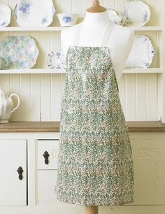 "William Morris Sweet Briar Pvc / Oilcloth Apron This Pvc / Oilcloth apron is 21 1/2"" (54.5 cm) Wide by 29 1/2"" (75 cm) Long and have natural cotton ties while each waist tie is 21"" ( 50.4 cm) long. The apron is 100% Cotton which has been coated in a soft feel clear gloss pvc coating. The apron has been printed, pvc coated and manufactured in the UK. The pvc apron is wipe clean."