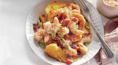 Enjoy all of the flavor and comfort of this classic Southern dish in a casserole that can be served family-style and comes together in just one hour. Fancy enough for company, but easy enough to pull off on any old Saturday, this Shrimp and Grits … Seafood Dishes, Seafood Recipes, Cooking Recipes, Brunch Recipes, Crawfish Recipes, Dinner Recipes, Brunch Menu, Cajun Recipes, Brunch Ideas