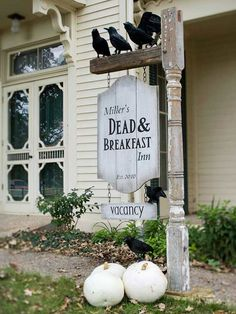 """#Halloween Sign. Create a hotel sign to welcome guests at the front door of your haunted Halloween abode. An old cast-off post gets new life when paired with a DIY sign. Simply assembled from 1x8-inch boards, the sign is painted and attached with eye hooks and chain to a vintage signpost. Be sure your sign reads """"vacancy"""" so trick-or-treaters will know they can approach."""