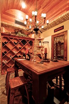 We love the table in this home wine cellar.