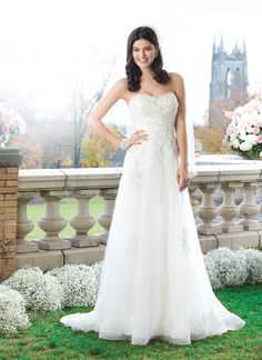 Sincerity wedding dress style 3758 This gown has a beaded lace and tulle sweetheart neckline with a drop  waist and tulle cage skirt with satin lining. The skirt�s hem features  lace and horse hair with floating lace appliques. The gown ends with an  illusion chapel length train and tulle buttons over the back zipper.