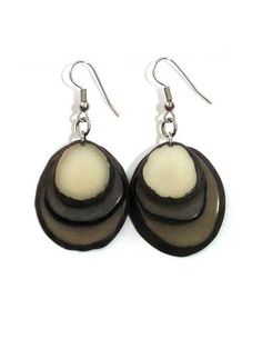 Tagua Trio Earrings $10.00 USD  - A trio of Tagua petals, in avocado, orange and grass. Striking simplicity. Stainless Steel earring hooks.  - Encanto Tagua is dyed with a biodegradable tincture that is used to also dye cotton and linen; these colors will not bleed or fade. Produced following fair trade principles.  - Artisan Country: Columbia…