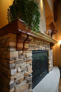 Our client wanted chunky and rustic. We decided on a natural flag stone, limestone hearth and knotty alder mantle. The effect was dramatic but not over the top. Home Fireplace, Fireplace Surrounds, Fireplace Design, Fireplace Stone, Stacked Rock Fireplace, Fireplace Ideas, Fireplace Inserts, Fireplace Refacing, Rock Fireplaces